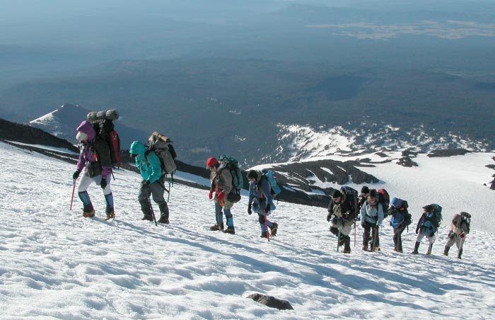 A conga line of mountaineers on their way to the summit of Mt. Adams.