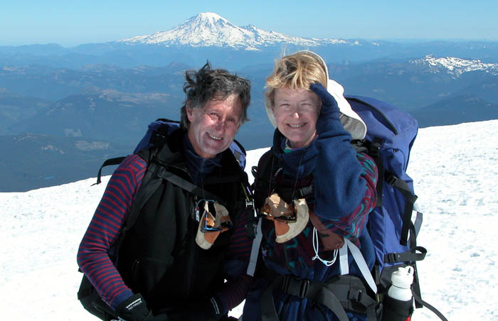 Ken and Lee on the summit of Mt. Adams with Mt Rainier behind and to the north of them