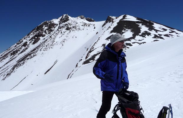 Peter at the top of the western slope (13,000') ... Shasta summit behind