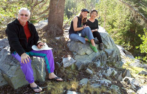 Mike, Kristy and Jeanne sitting on the edge of the escarpment by Luna Lake