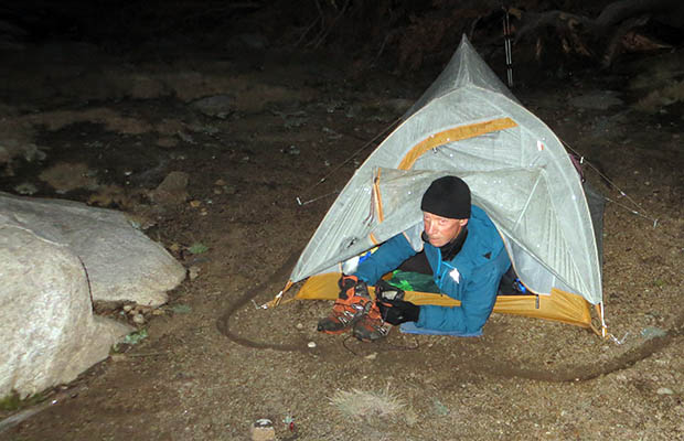 Bubbs Creek nightmare: frozen in our tents - Peter crawling out under the vestibule fly