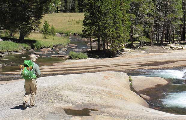 Benjamin on the granite slabs of the Tuolumne River
