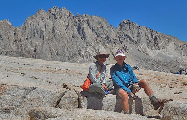 Jeanne and Peter on the summit of Knapsack Pass. Nth Palisade & Polomonium peaks behind
