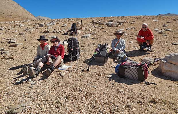 Louise, Mark, Jeanne and Bob resting on the highest point of the Bighorn Plateau