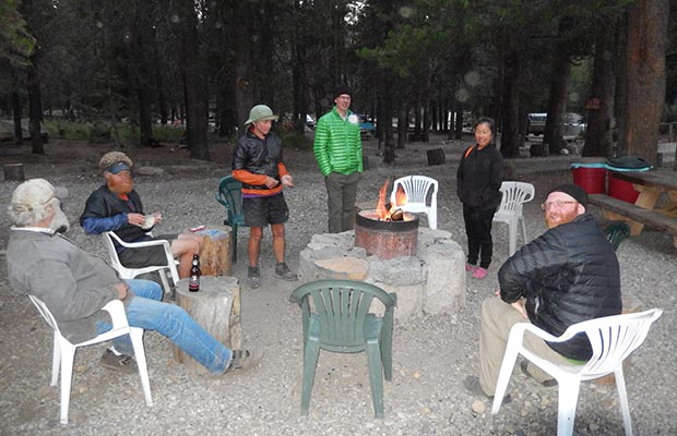 Jeanne and David with PCT thu-hikers sitting around the evening fire [2014]