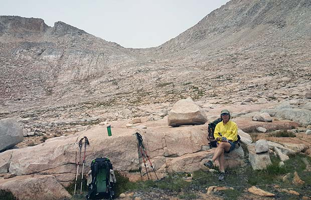 Bob resting on the southern side of Italy Pass ... the low point on the skyline