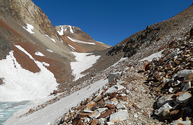 Traversing the trail below McGee Pass, with a steep snow section ahead