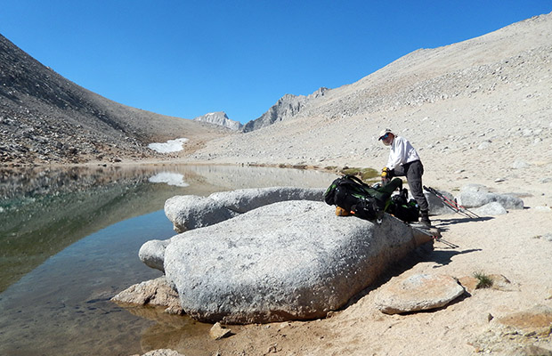 Bob on the rocks of Summit Lake with Mono Pass [12,000'] in the background