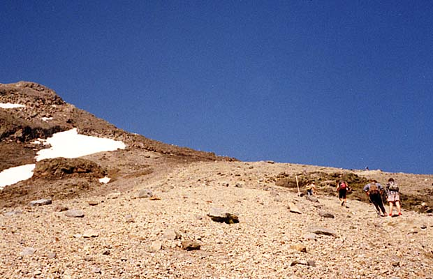 Almost off the scree and onto the Lizard ... the rock ridge visible on the skyline.