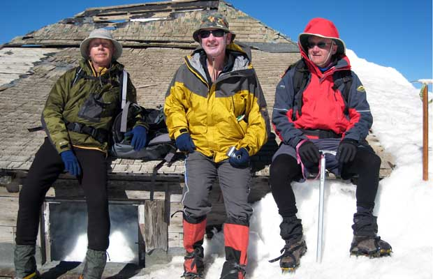 2007: Peter, Mal and Foxie sitting on the fire observation hut at the summit.