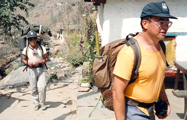 Sherpa Dorje and Martin passing through a village.