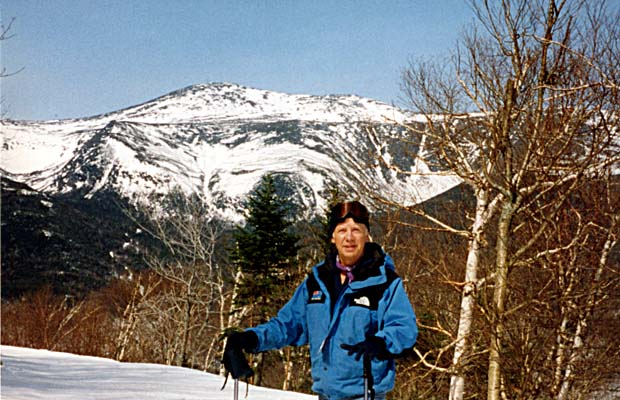 Skiing at Wildcat with Mt Washington, Tuckerman Ravine and Lion Head in the background.