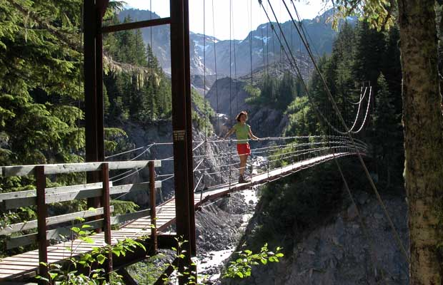 The suspension bridge that crosses the deep wash-out of Tahoma Creek