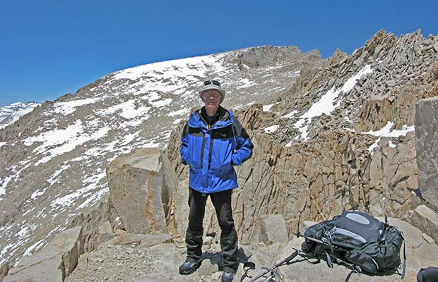 May 2009: Me on the trail along the back-side of the Needles. The summit of Whitney behind.